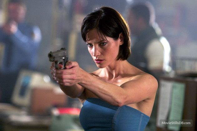 Jill Valentine appears in the film series second film where she is played by Sienna Guillory. Source: MovieStillsDB.com